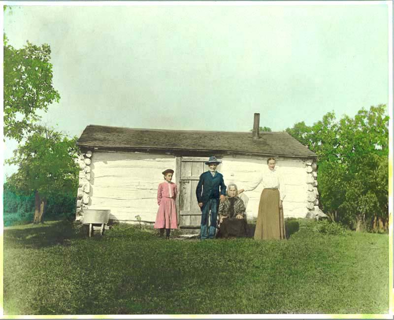 Pioneers by their log cabin