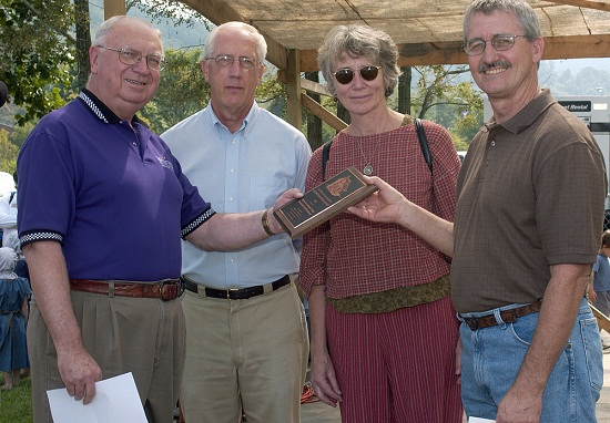 Haywood Community College's Professional Crafts Program received the 2005 Mountain Heritage Award during festivities at Western's 31st annual Mountain Heritage Day on Saturday, Sept. 24. HCC representatives (right to left) Gary Clontz, chair of the department of professional crafts; Catherine Ellis, fiber arts instructor; and Bill Rhodarmer, assistant vice president for academic services; accept the award from Clifton Metcalf, Western's vice chancellor for advancement and external affairs.