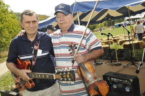 "Two Cherokee County natives, fiddler Gar Mosteller (right) and guitarist Doyle Barker, were named recipients of WCU's Mountain Heritage Awards during a ceremony at WCU's Mountain Heritage Day. The duo has performed ""Appalachian swing"" music at the festival since 1990. (WCU photo by Ashley T. Evans; 9-27-08)"