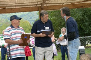 Scott Philyaw presenting the Mountain Heritage award to Gar Mosteller and Doyle Barker, 2008