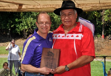 Lloyd Arneach [right] receiving the Mountain Heritage award from WCU Chancellor David O. Belcher [left].