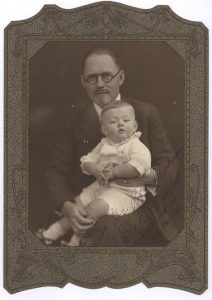 """Dr. Brinkley with an unidentified child. The Photograph is inscribed """"To Professor Rob't. Madison, John R. Brinkley, Milford, KS, May 17 - 1930."""""""